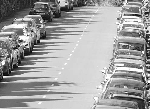 parked cars on long road